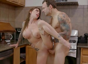Seductive kitchen XXX action with the hot tattooed mommy