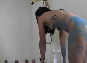 Eccentric artist masturbates while being covered in blue paint